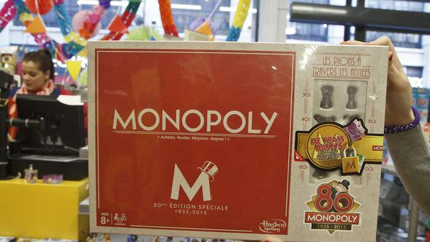 The French version of Monopoly is celebrating its 80th year by slipping cash into 80 boxes of the game (AP)
