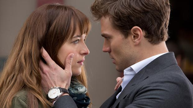 Dakota Johnson as Anastasia Steele and Jamie Dornan as Christian Grey in the film Fifty Shades of Grey (Universal Studios/PA)