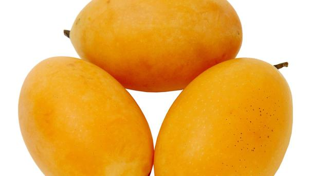A mango plum is a tropical fruit that is a cross between a plum and a mango (Marks and Spencer/PA)