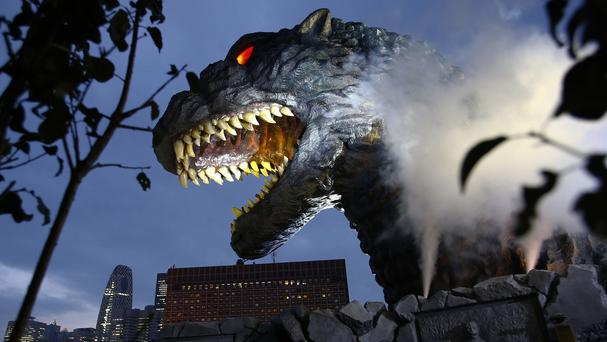 Godzilla's head is unveiled as the irradiated monster was appointed special resident and tourism ambassador for Tokyo's Shinjuku ward (AP)