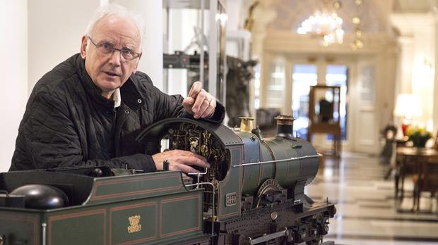 Pete Waterman with a model of the Great Western Railway Class 3700 4-4-0 tender locomotive No 3440 'City of Truro', which he is selling (Dreweatts and Bloomsbury Auctions/PA)