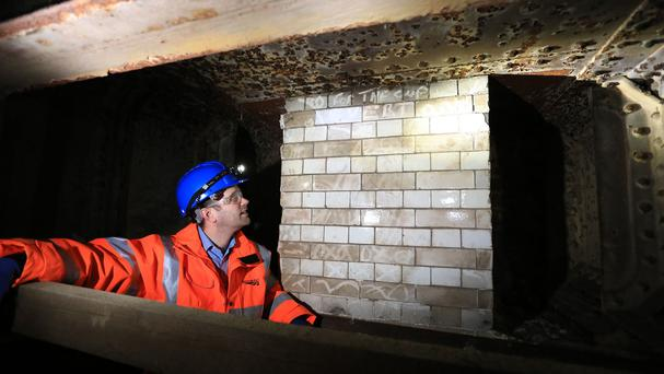 Project manager Greg Thornett looks at the remains of Southwark Park station, a
