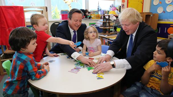 Prime Minister David Cameron and Mayor of London Boris Johnson during a visit to Advantage Children's Day Nursery in Surbiton, Surrey