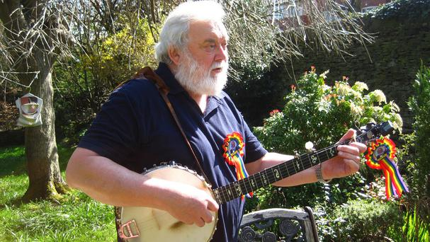 Joe Stead, who is known as The Singing Politician, playing the banjo at his home in Sowerby Bridge