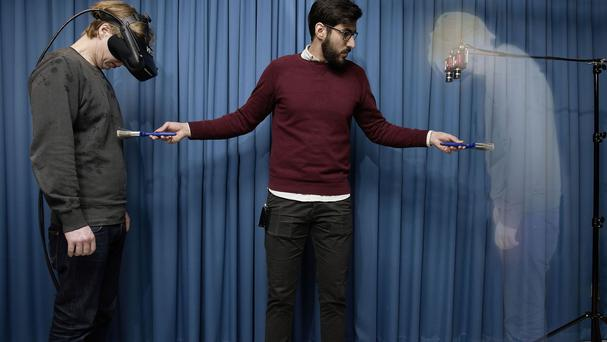 A person creating the Invisible Man illusion using a 3D virtual reality headset that projects an image of empty space when participants looked down at their own bodies (Staffan Larsson/Karolinska Institute/PA)