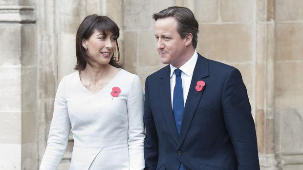 Prime Minister David Cameron has credited his wife Samantha for 'keeping me sane'