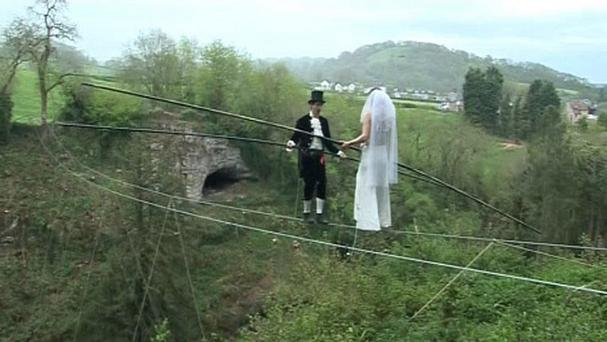 Chris Bull and Phoebe Baker during rehearsals to take their vows in England's first high-wire wedding at Wookey Hole Caves in Somerset.