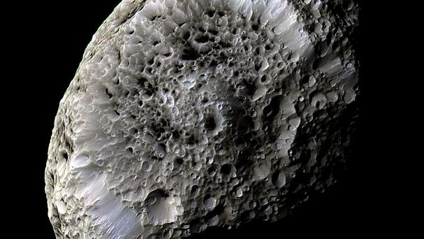 One of Saturn's outer moons, Hyperion, snapped in incredible detail by the Cassini spacecraft (Nasa/JPL/Space Science Institute/PA)