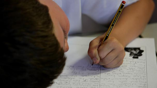 The marking of pupils' work could be cheaply outsourced, an expert has said