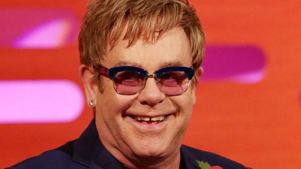 Sir Elton John is known for his flamboyant outfits