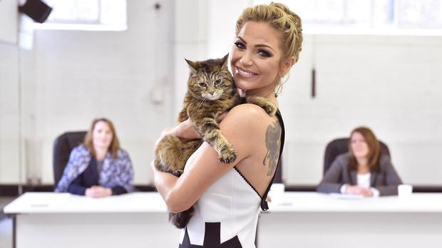 Sarah Harding holds Sydney, a domestic short haired cat from Guildford, during the auditions to find Britain's Happiest Cat and the new face of O2 Refresh