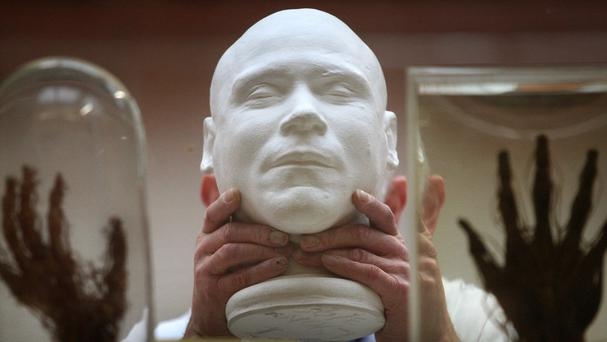 The death mask and skeleton of mass murderer William Burke are on display in the Anatomy Museum at the University of Edinburgh