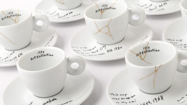 A collection of espresso cups and saucers by Yoko Ono feature the dates and places of six tragic events including the shooting of husband John Lennon (Illy North America/AP)