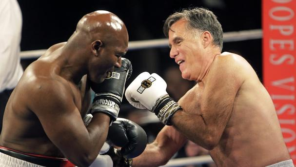 Mitt Romney and Evander Holyfield in their charity fight in Salt Lake City (AP)