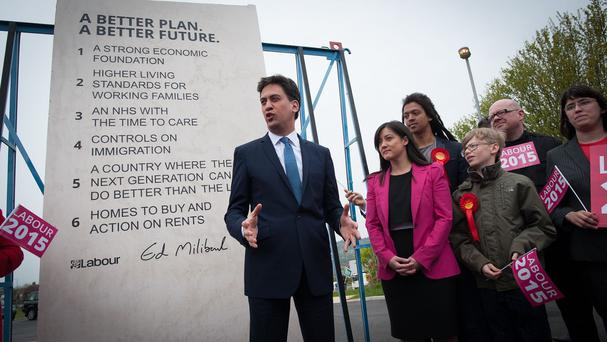 Ed Miliband with Labour's General Election pledges carved on a stone plinth