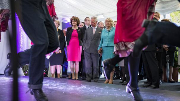 The Duchess of Cornwall and the Prince of Wales watch an Irish dancing performance on the first day of their Royal visit to the Republic of Ireland.