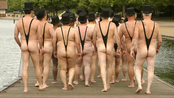 People dressed in mankinis walk along the jetty of the Serpentine boat house in London's Hyde Park
