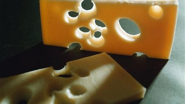 Experts have solved the mystery of why the holes in Swiss cheese can disappear (AP)