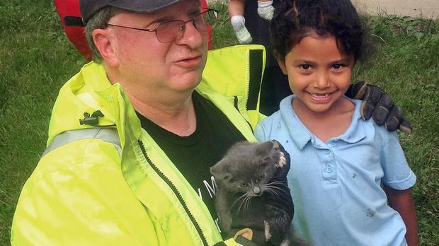 Lancaster Township Fire Department Deputy Fire Chief Glenn Usdin holds the kitten rescued with the help of six-year-old Janeysha Cruz (AP/Lancaster Township Fire Department)