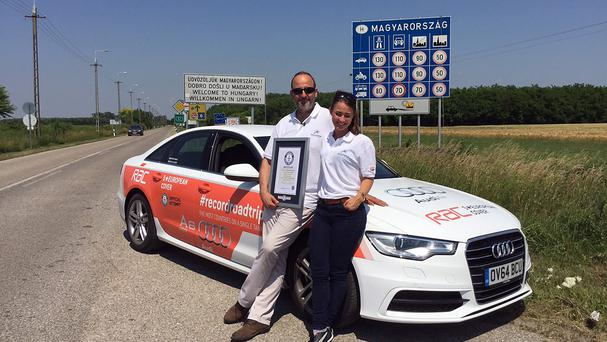 Motoring journalist Andrew Frankel and racing driver Rebecca Jackson in Hungary after they drove an Audi A6 Ultra a total of 1,158 miles almost non-stop for nearly 28 hours (RAC/PA)