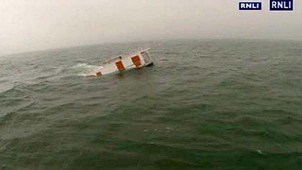 A hot tub floating at sea after breaking loose from a houseboat that sank (RNLI/PA)