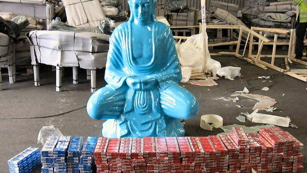A statue of a Buddha that was filled with cigarettes was discovered by Border Force officers at Southampton Port (HMRC/PA)