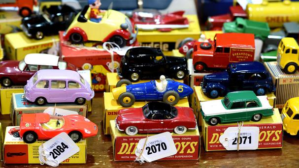 Around a fifth of adults admit to playing with toy cars when their children are not around, a poll has found