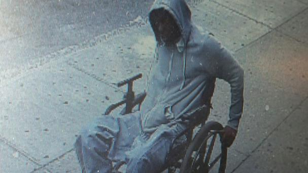 A man gets away after he robbed the Santander bank in the Queens borough of New York (NYPD via AP)