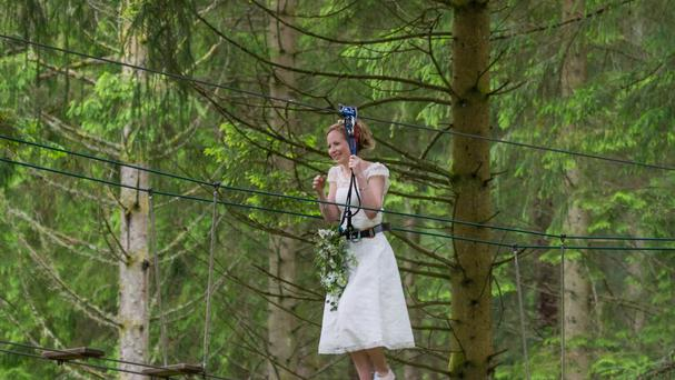 Bride Colette Gregory walks down the aisle (PA/Go Ape)
