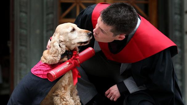 Edinburgh Napier University student Jack Proctor with his dog Fudge as he collects his degree