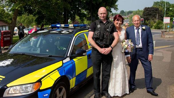 Dianne Hunnibell with her father Peter and Suffolk Police traffic officer Pc Ian Jepp who helped the bride get to Stowmarket Registry Office for her wedding after her vintage Rolls Royce broke down (Suffolk Police/PA)