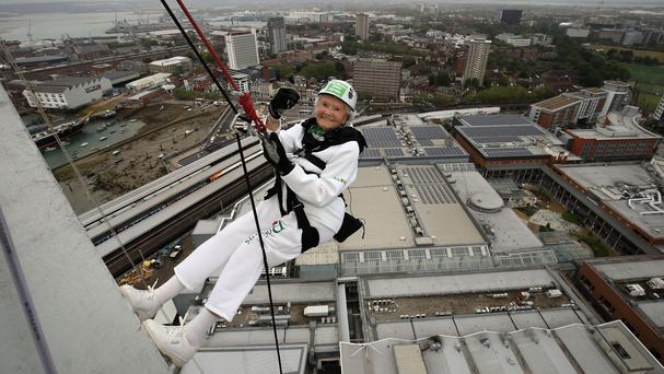 101-year-old Doris Long as she abseils down the Spinnaker Tower in Portsmouth, Hampshire.
