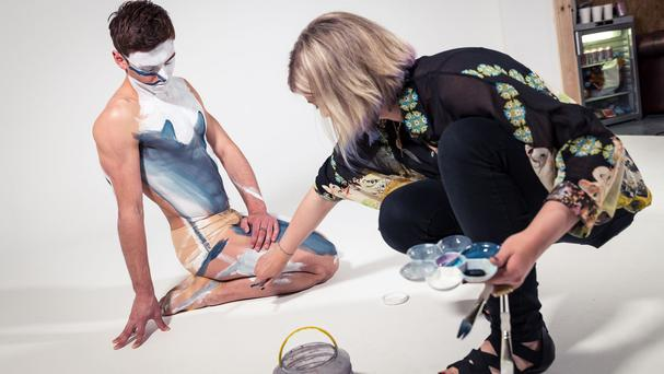Olympic diver Tom Daley swapping his swimming shorts for shark skin-style body paint to raise awareness of the important role sharks play in the ecosystem. (PA)