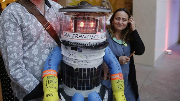 HitchBOT, a hitchhiking robot, is introduced to an audience at the Peabody Essex Museum (AP)