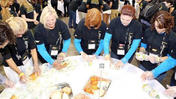 Members of Team Subway set a new Guinness World Record title for most people making sandwiches simultaneously (Invision for Subway Restaurants/AP)