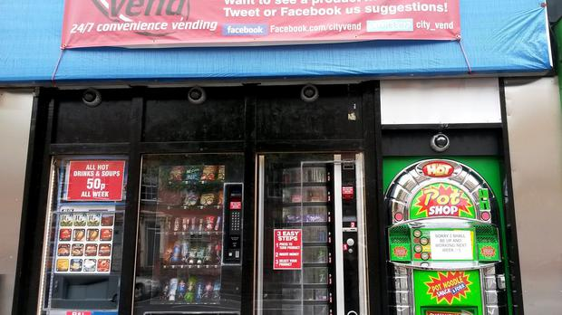 A Pot Noodle vending machine (right), which has been installed on Mansfield Road in Nottingham.