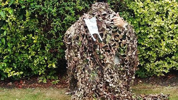 Andrew Hawes has taken to hiding in bushes in camouflage to catch dog walkers who leave a mess behind
