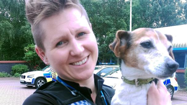 PC Natasha Susnik from Warwickshire Police with Molly the Jack Russell who was reunited with her owners in County Durham after she was stolen in a burglary seven years ago (Warwickshire Police/PA)