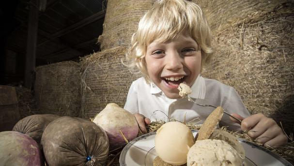 Zak Reid, seven, tries out haggis ice cream (PA/Glen Urr)