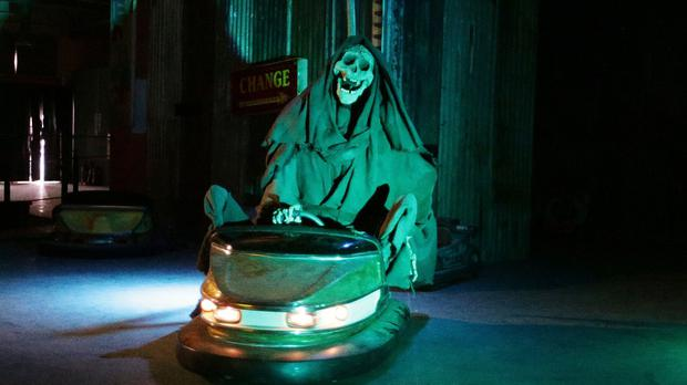 The grim reaper rides the dodgems at Dismaland