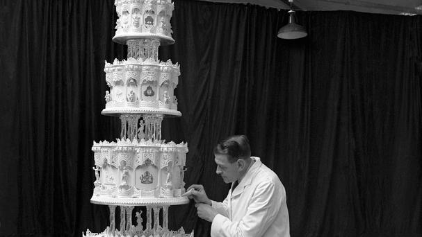 The cake by McVitie & Price was made of four tiers, was 9ft high and weighed around 500lb
