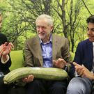 Labour party leader Jeremy Corbyn (centre) is presented with a marrow uring a visit to the Brighton Hatchery