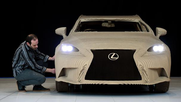 Ruben Marcos, of Scales and Models, inspects the wheel on a full-size origami inspired Lexus IS saloon