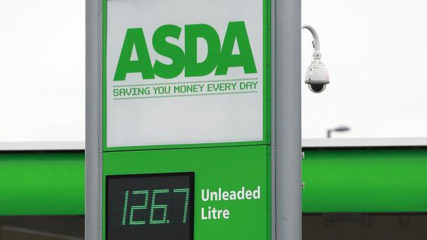 A burglar called 999 when trapped by a petrol station's security device during a break-in
