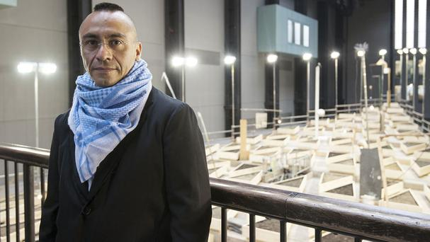 Artist Abraham Cruzvillegas in front of his Empty Lot at Tate Modern (PA)