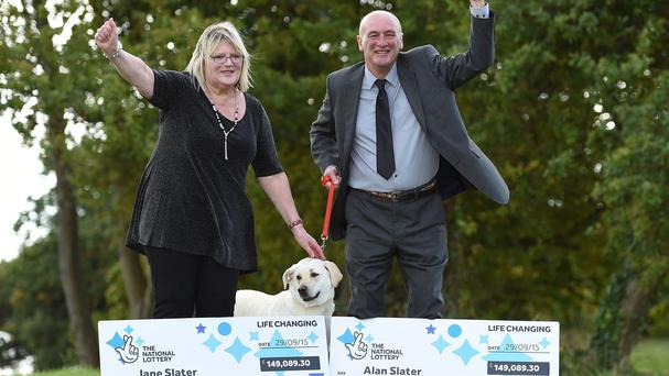 Jane and Alan Slater celebrate a double win on Euromillions with their labrador Ruby after she uncovered their second winning ticket