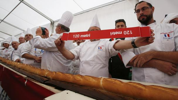 The baguette was declared the world's longest by a Guinness World Record judge (AP)