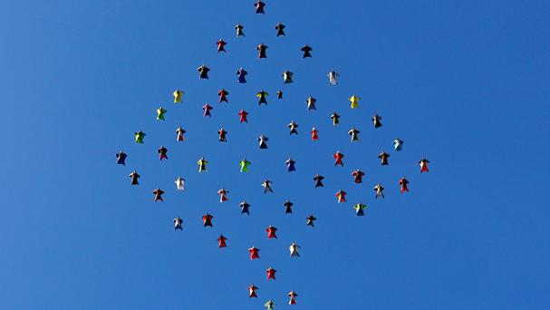 The wingsuit skydivers set a new world record for the largest aerial formation in the sky over Perris, California (Skydive Perris/AP)