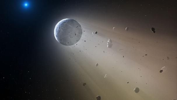 Artist impression of a planetoid disintegrating as it is destroyed by a white dwarf