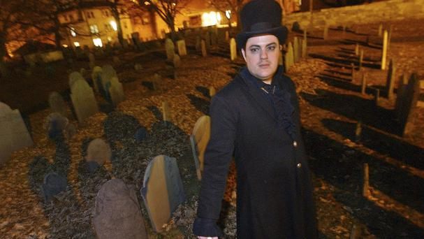 Christian Day poses in the Old Burying Ground in Salem, in December 2003 (AP)